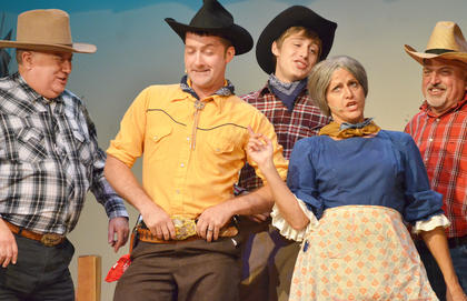Will Parker, portrayed by Chad Shively of Campbellsville, and Suzanne Bennett, formerly of Campbellsville, who played Aunt Eller, sing together.