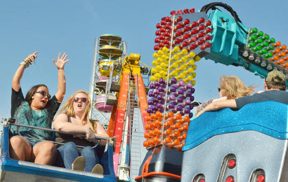 Fairgoers are excited to ride the Orbiter.