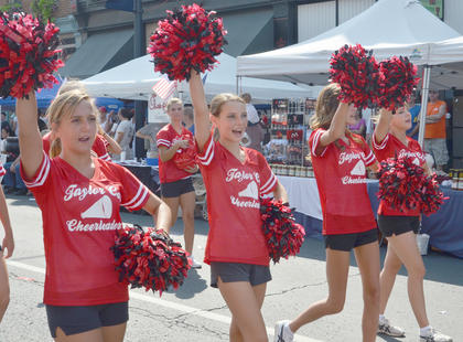 Taylor County High School cheerleaders show their spirit during the parade.