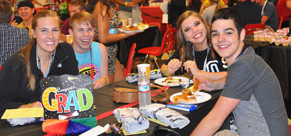 From left, Hannah Sadler, Timmy Mills, McKenzie Lawson and Wes Phillips enjoy some late night snacks at TCHS Project Graduation on May 24.