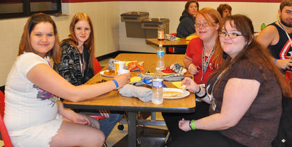 Sitting in the TCHS cafeteria for the last time is bittersweet for these friends. From left are Jessica Crabtree, Megan Bray, Theresa Cox and Christina Rakes.