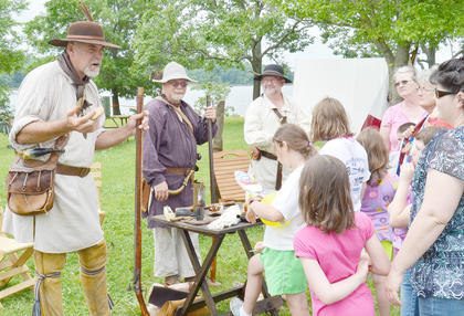 Re-enactors teach area children about weapons from the past.