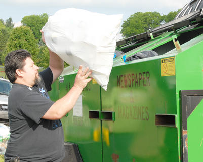Taylor County Conservation District hosted a Recycling Day on Saturday, April 28, to encourage residents to recycle. Those who recycled received a free recycling container and two trees from the state's Division of Forestry. Above, Roger Bast of Campbellsville recycles some plastic bottles.