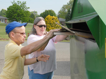 Taylor County Conservation District hosted a Recycling Day on Saturday, April 28, to encourage residents to recycle. Those who recycled received a free recycling container and two trees from the state's Division of Forestry. Above, Lloyd Marsh and Marlita Marsh of Campbellsville recycle some cardboard.