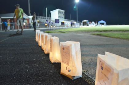 Luminaries purchased in honor of those fighting cancer or who have died of cancer glow after dark on Friday night.