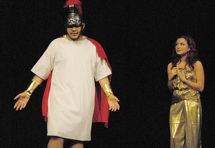 Odysseus, portrayed by Ozzie Delgado, tells Circe, played by Kathryn Hieneman, that he must leave her party, which lasted for years, to go home.