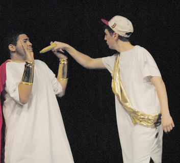 Jacob Lee, a suitor competing for Penelope's hand in marriage, threatens Odysseus, Penelope's husband, with a banana.