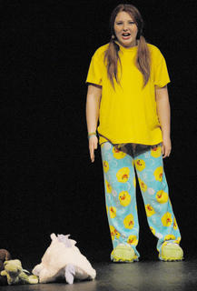 """Before """"SeussOdyssey,"""" TCHS drama students performed monologues. Here, Brittany McFarland performs """"March In Line,"""" where she tells her stuffed animals to behave."""