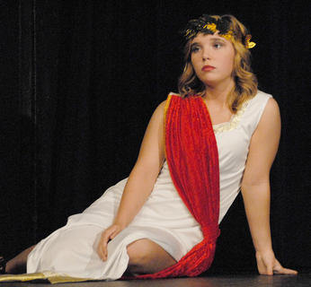 McKenzie Lawson portrays Penelope, who is in search of a suitor after her husband, Odysseus, disappeared for many years.