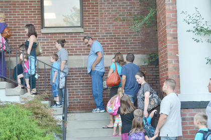 Students and parents wait to get into the TCES building on Tuesday morning.