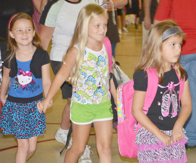 TCES students, from left, MaKayla Underwood, Madison Douglas and Jordyn Farmer head to class.