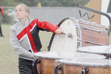 Thirteen area bands competed at the annual Taylor County Marching Invitational on Saturday at Taylor County High School. The TCHS band performed in exhibition. TCHS percussionist Gabby Doerr performs in exhibition on Saturday night.