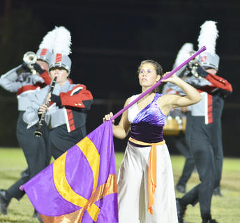 From left, clarinet player Brianna Handy and color guard member Allison Miller perform with the TCHS band.
