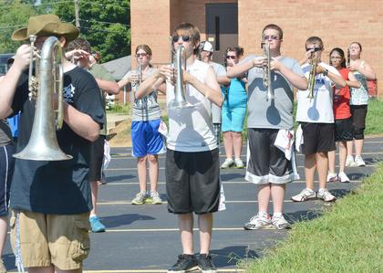 TCHS marching band members practice fundamentals at band camp on Tuesday.