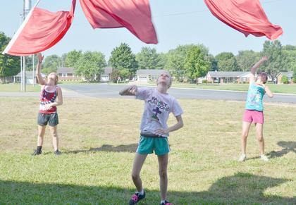 TCHS color guard members practice a toss on Tuesday at band camp.