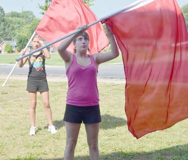 TCHS guard members Natasha Benedict, at left, and Emily Sherrard practice a drill during band camp on Tuesday.