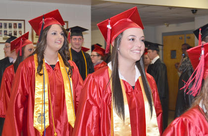 Taylor County High School graduated its largest class in school history on Friday night when 257 students crossed the stage to get their diplomas. Students gathered together before the ceremony to take photos together and talk and then filed into the TCHS gymnasium to graduate. Many decorated their caps with glitter, buttons and more.