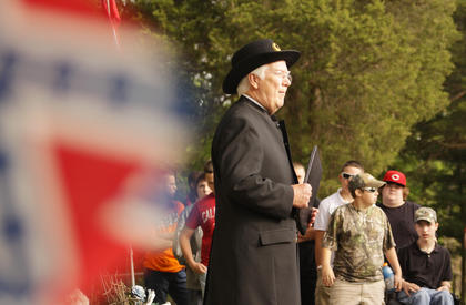 Paul Patton, former Taylor County judge/executive, portrays a Civil War chaplain at the Confederate cemetery near Tebbs Bend Battlefield on Friday. Patton and others gave first-person presentations to students from the Campbellsville and Taylor County school districts.