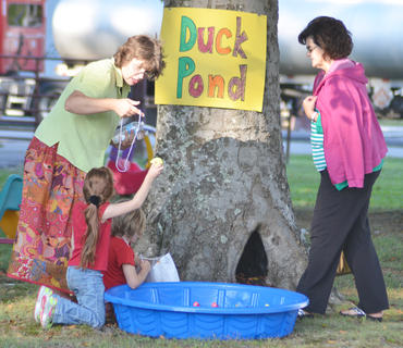 Tara Hall, at left, pastor at Stoner Creek United Methodist Church, helps children play games during youth night.