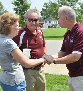 CU President Dr. Michael Carter, at right, greets Denise Gray Smith, a CU alum from Cincinnati, Ohio, at an ice cream social on Saturday. Smith said the 10th member of her family is attending CU this semester as a freshman. Dr. Frank Cheatham, vice president for academic affairs, is also pictured.