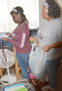 DeAnna Davison of Radcliff organizes her belongings, with help from her mother, Emma.