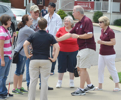 CU President Dr. Michael Carter and his wife, Debbie, greet students at an ice cream social on Saturday.
