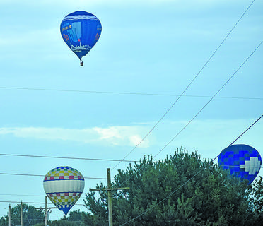 Hot air balloons fly over Campbellsville on the morning of the 4th of July.