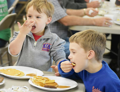 Asher, left, and Axel Ewing enjoyed the pancakes and sausage at the Fire Department's annual Pancake Breakfast