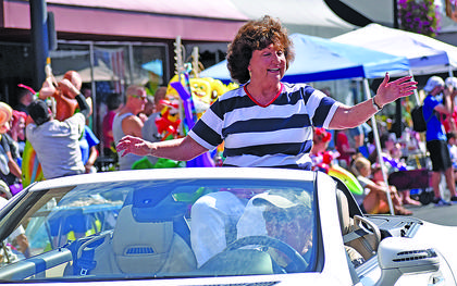 Campbellsville Mayor Brenda Allen waves to the crowd during Thursday's Fourth of July parade.