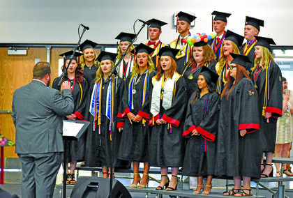 Members of the Taylor County choir sing during Friday's graduation.