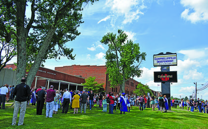 Students met their families on the lawn in front of the Hamilton Auditorium after ceremonies were over as the school sign flashed 'congrats' at the new grads.