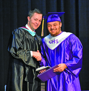 Weston Jones, Campbellsville High School principal, shakes hands with Austin Lane.