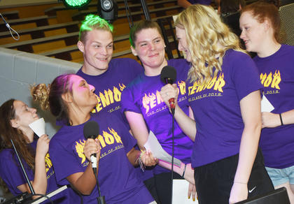 From left, CHS seniors Christa Riggs, Reagan Knight, Joe Pipes, Cassie Pipes, Abbie Dicken and Gracie Miller sign karaoke at project graduation.