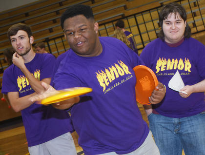 CHS senior Jeremiah Jackson plays a Frisbee game at project graduation, as Layton Hord, at left, and Jim Jefferies wait their turn.