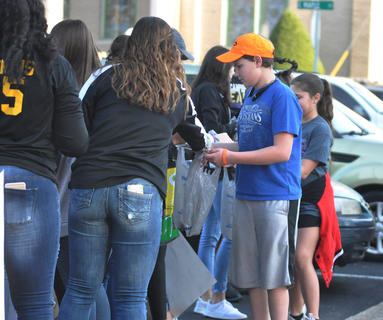 Members of the Campbellsville High School girls basketball team hand out candy Tuesday night.