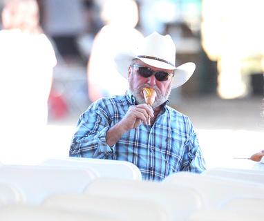 Rick Yankey of Liberty enjoys a corn dog at the Taylor County Fair.