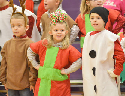 """From left, Cameron Estes, Chyanne Christie and Keaton Hord sing and dance to """"Jingle Bells."""""""