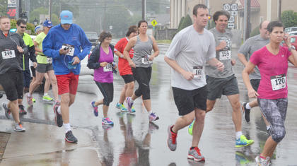 Despite Saturday morning's rain, 58 people ran and walked during the Campbellsville Kiwanis Club's first Donut Dash.