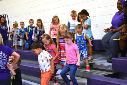 Campbellsville Elementary School students exit the gym and head to class on the first day of school.