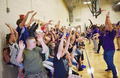 Campbellsville Elementary School students do the wave on the first day of school.