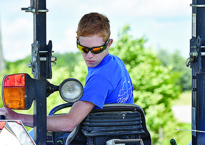 Aiden Cox, 15, won first place championships in the senior division of both the tractor driving and lawn tractor driving contests. Cox will move on to the next level of competition for both events, and the Kentucky State Fair could be the next level, depending on whether or not there are any area competitions this year.