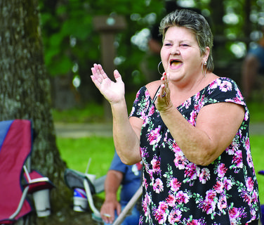 Debra Rodriguez, of Russell Springs, was in a dancing mood during one of the several musical performances throughout the event.