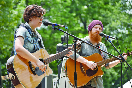 """Hannah Coomer (left) and Eric Scott, of The Folk Project, perform a song from their album """"Traveler's Bag"""" on Saturday afternoon."""