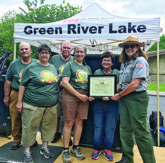 Green River Lake Manager Lori Brewster (right) presents a certificate of appreciation to members of the Friends of Green River Lake. Shown from that group are, from left, David Buford, Sharion Abney, Bud Mirus, Lori Bell and Cora Mirus.