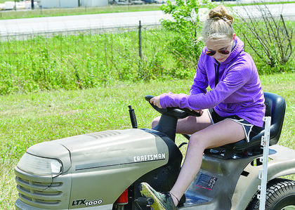 Hana Marcum, 14, navigates the lawn tractor driving contest. She was the reserve champion for the senior division of the competition.