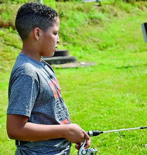 Brayden Williams, 12, of Taylor County, waits patiently to try and get a bite.
