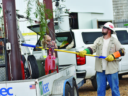 Wes Honadel of Taylor County RECC demonstrates the importance of staying clear of power lines with farm equipment.