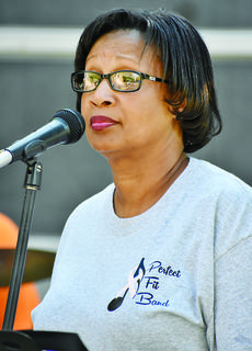 """Mardena Compton gets ready to sing her part during the band's cover of """"I Shot the Sheriff."""""""
