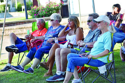 Members of the crowd watch as the Perfect Fit Band plays. Several people were in attendance to watch the band's performance on Friday night.