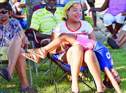 Sienna Barber (seated), 10, and Anaya Buenrostro, 7, have some fun while attending the free concert.